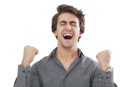 happy young man: Young men with arms up celebrating his success