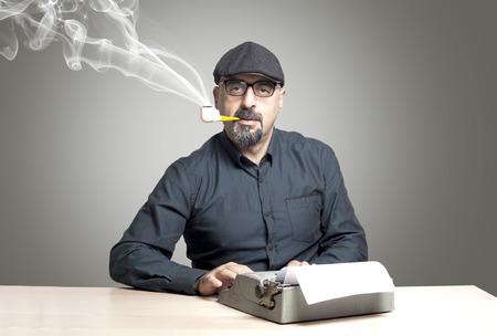 The man writing on typewriter photo