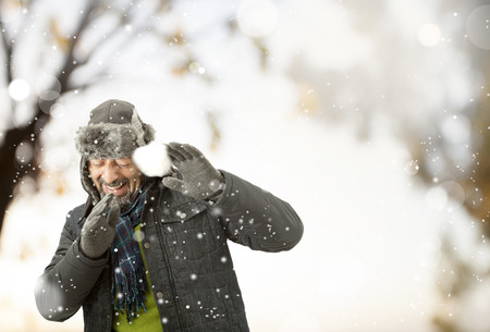 one senior man only: A man playing with snow