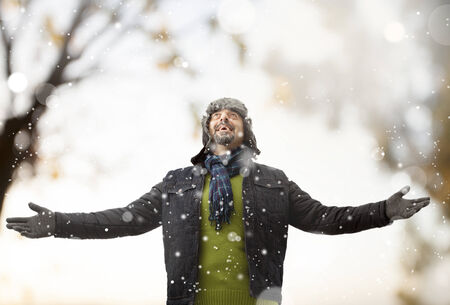 snow flakes: A man playing with snow