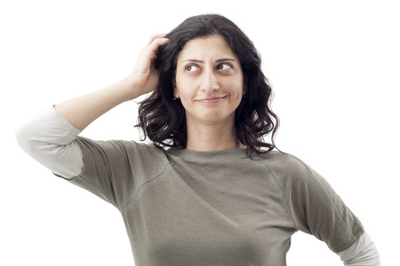 scratching head: Young woman scratching her head Stock Photo