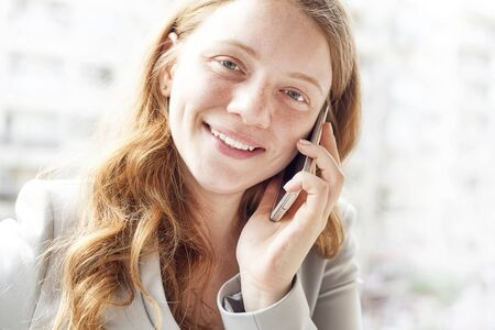 Young woman talking mobile phone photo