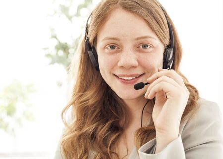 customer service representative: Portrait of happy young female with headset