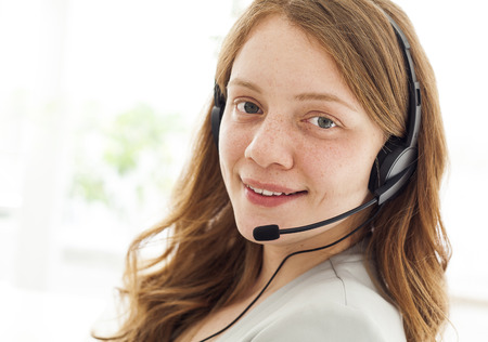 center agent: Portrait of happy young female with headset