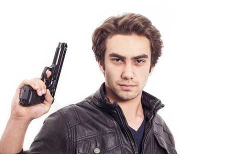 man holding gun: The man holding a gun Stock Photo