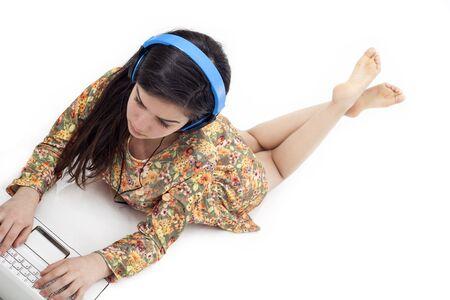 Teenage girl in headphones listening to the music
