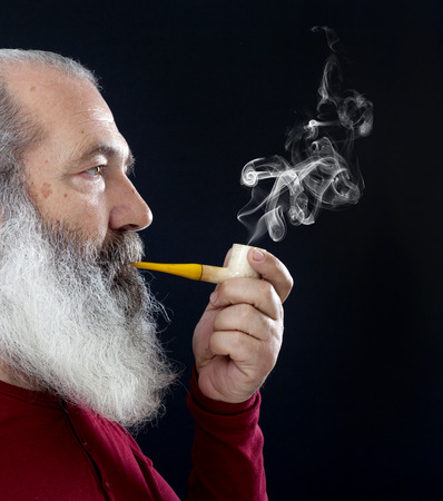 old man beard: Senior portrait with white beard and pipe