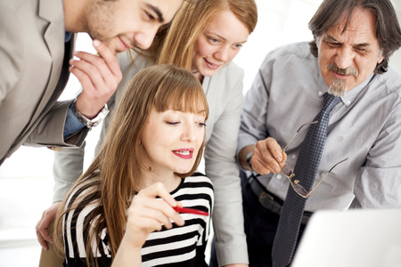 Business people working as a team at the office Stock Photo