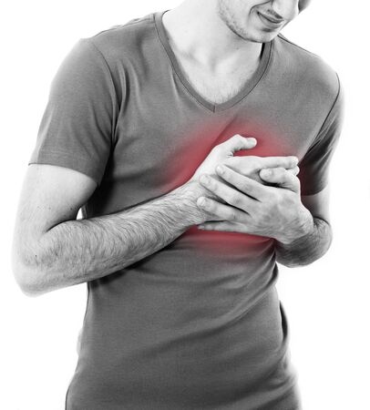 heart pain: Man having a pain in the heart area