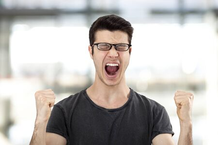 energetic people: Portrait of a young man with her fist raised