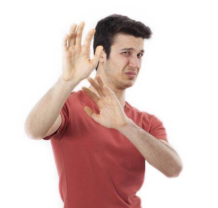 Closeup portrait of scared man raising hands up in defense