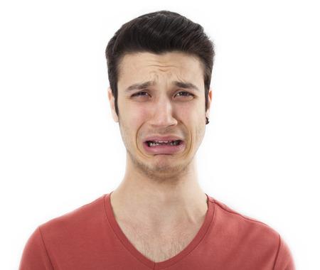 caras tristes: Hombre joven triste llorando Foto de archivo
