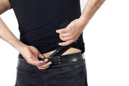 A man with a gun his pants