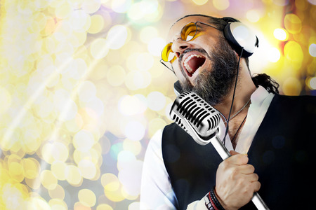 singer with microphone: Singer man Stock Photo