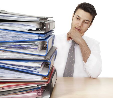 overloaded: Worried businessman with folders