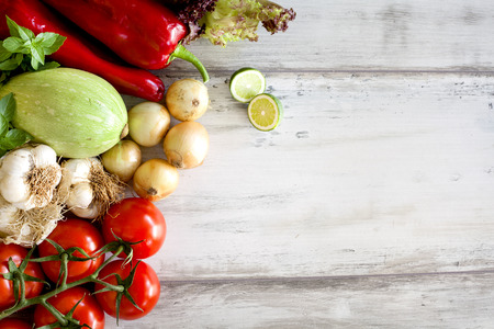 table top: Assortment of fresh vegetables on wooden background