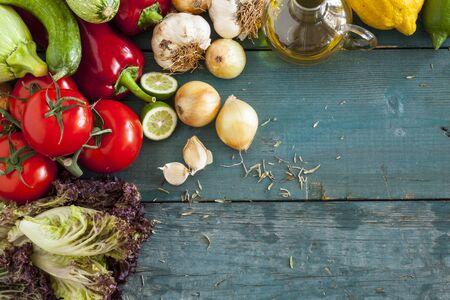 olive green: Assortment of fresh vegetables on wooden background