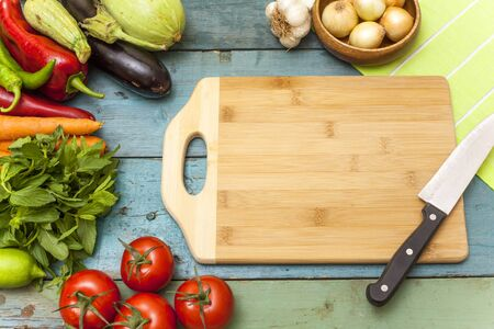chopping: Assortment of fresh vegetables and chopping board Stock Photo