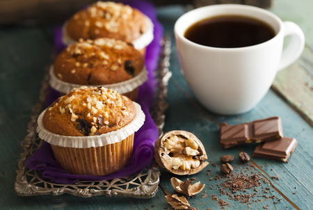 sweet table: Muffin cakes in silver tray with cup of coffee Stock Photo