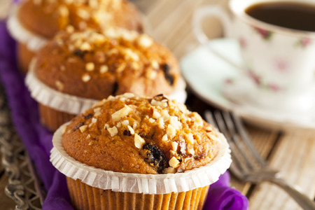 silver tray: Muffin cakes in silver tray with cup of coffee Stock Photo