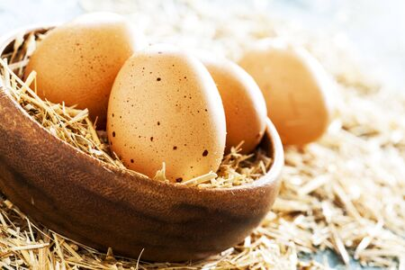 chaff: Eggs in wooden bowl Stock Photo