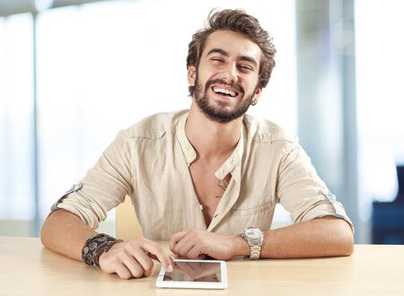 young man portrait: Young man using digital tablet