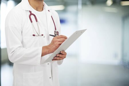 write background: Doctor man in hospital