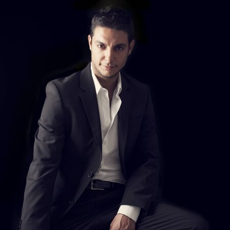 portrait man: Young man on black background
