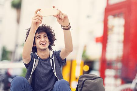 young man portrait: Young man taking self portrait
