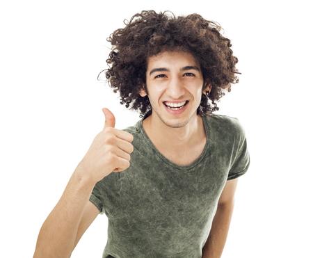 caras felices: Hombre joven que muestra signo de OK con el pulgar arriba Foto de archivo