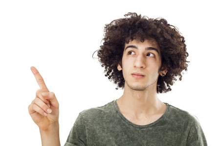 man pointing up: Smiling young man pointing up Stock Photo
