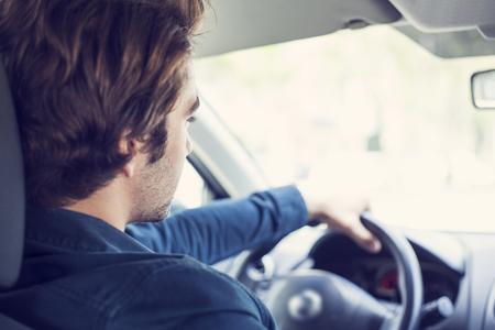 driving a car: Young man driving car Stock Photo