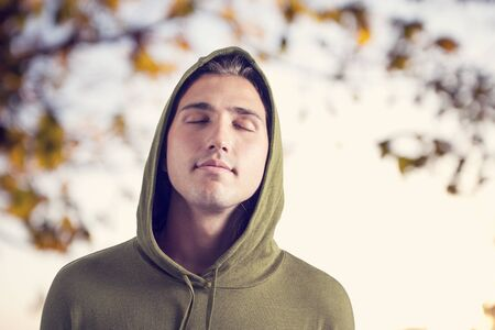 close portrait: Relaxed young man in park Stock Photo