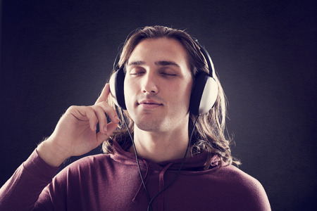 listening: Young man listening music with headphones Stock Photo