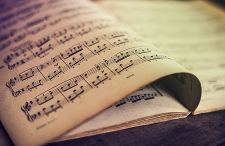 music book: Music sheets on wooden background Stock Photo