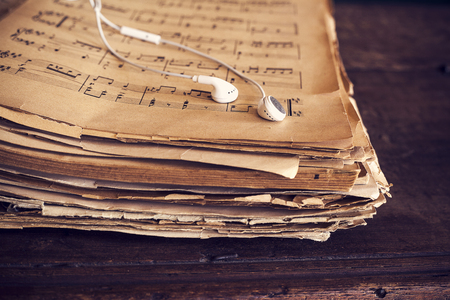note: Music sheets on wooden background Stock Photo