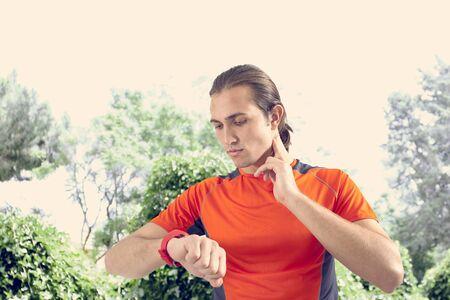 PULSE: Sports man checking pulse