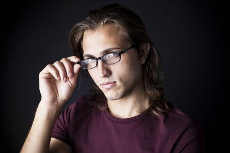 man with long hair: Portrait of young man