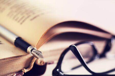 fountain: Book, fountain pen and eyeglasses