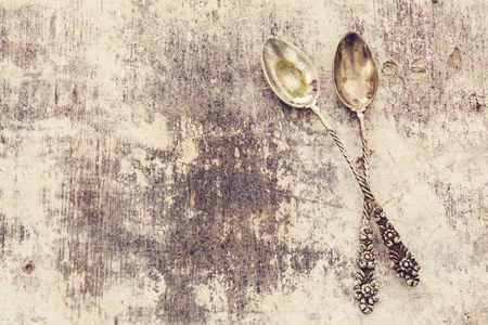 two object: Old spoon on wooden table Stock Photo
