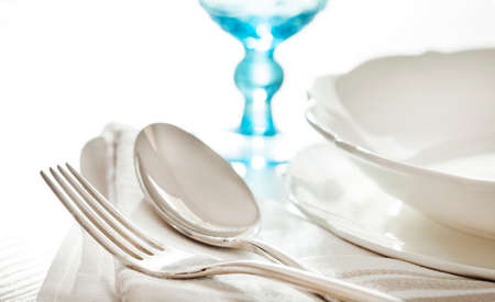 food dish: Table setting with fork, spoon and glass