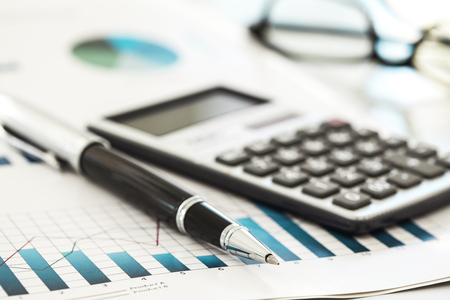 charts graphs: Calculator and pen Stock Photo