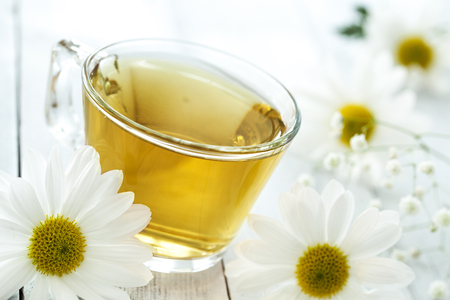 chamomile flower: Cup of tea with chamomile flower