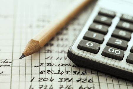 financial audit: Calculator and pencil Stock Photo