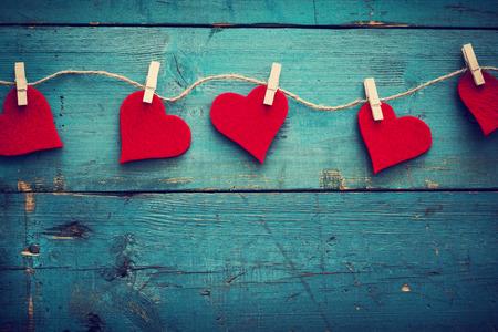 valentin: Valentines day hearts on wooden background Stock Photo