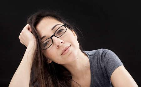 Portrait of woman on black background Stock Photo