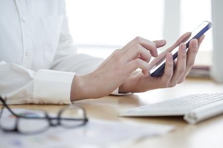 using phone: Businesswoman using mobile phone