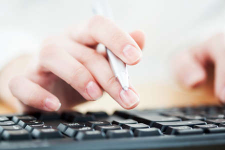 inputting: Woman hands on keyboard Stock Photo