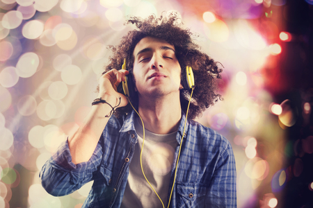 Young man listening music with headphones Banco de Imagens