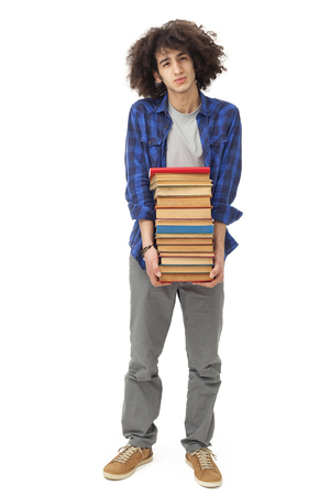 person reading: Male student carrying heavy books Stock Photo